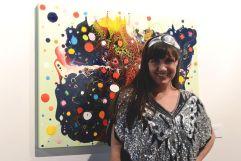 Vista Del HummingBird (artist in front of her own work)