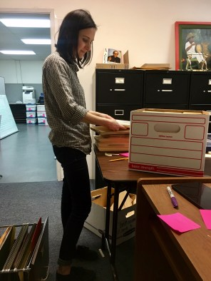 Amy selecting material to be boxed