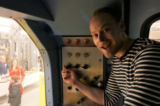 Me getting all excited twiddling the knobs in the front of an experimental train designed for the Central line in the 1990s.
