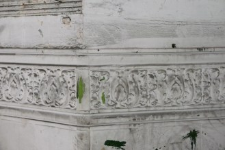 Sections of original tilework survive, whitewashed over.