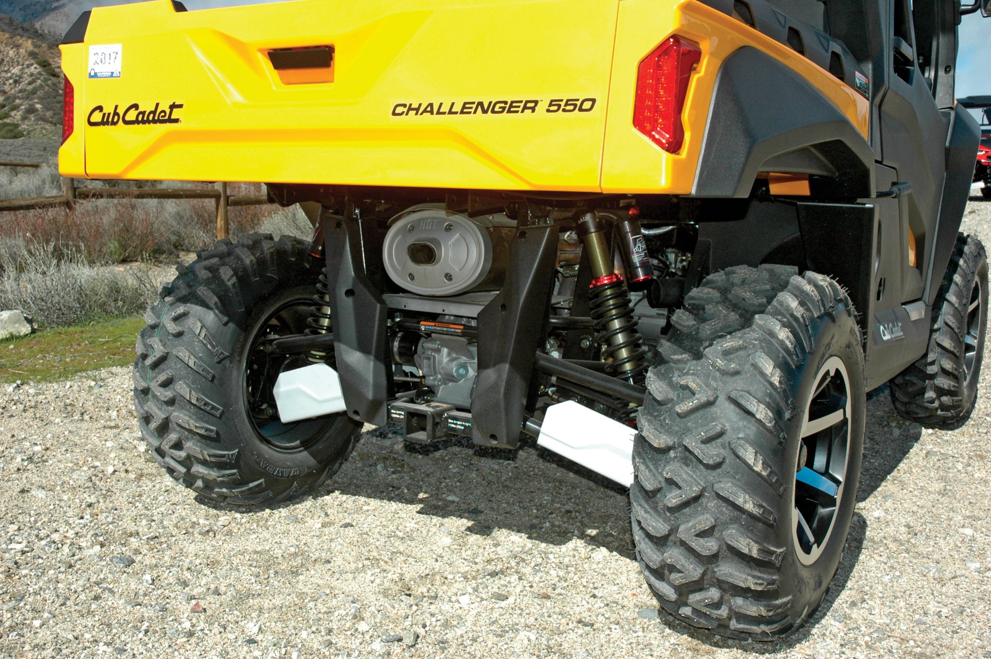 hight resolution of with its tilting bed and 2 inch hitch receiver the challenger is ready for work compression rebound and spring preload adjustable piggyback reservoir