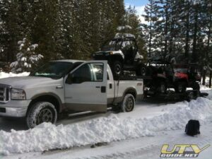Three UTVs with one tow rig