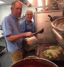 Bill and Tom cook dinner at Torres Shelter.