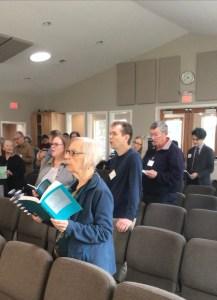 people singing in worship