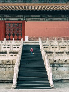 Man sweeping Temple staircase