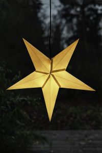 Golden star hanging in a window