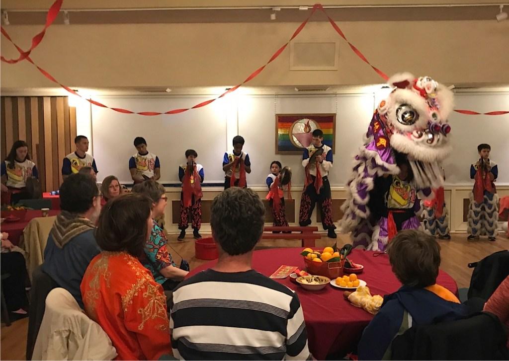Musicians arrayed behind a single lion