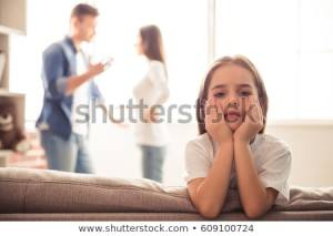 sad-little-girl-looking-camera-450w-609100724