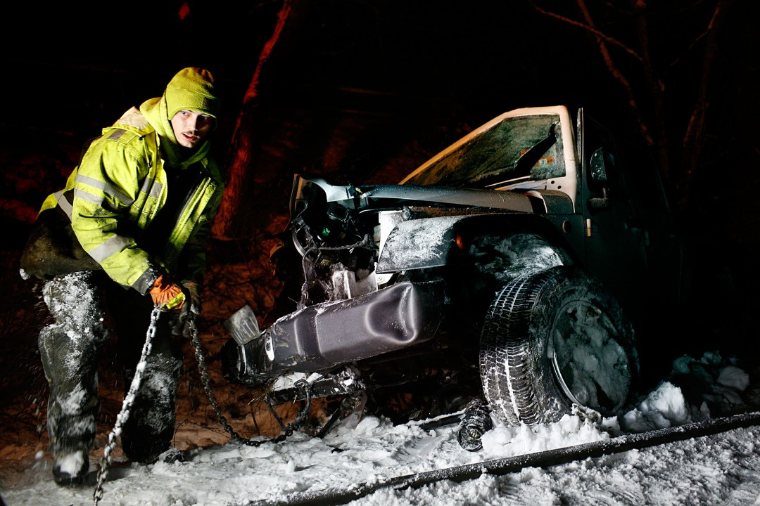 Nick Stickney of Blakeman's Towing & Recovery works to remove a Jeep Wrangler from the ditch after it was struck by an Amtrak passenger train in South Royalton, Vt., on Jan. 18, 2018. Police said the Jeep's driver was trying to pull another car out of the snow at the time of the crash. No one was injured. (Valley News - Geoff Hansen) Copyright Valley News. May not be reprinted or used online without permission. Send requests to permission@vnews.com.