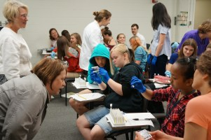 Students experiment with blood coagulation during Girls Science Discovery Day.