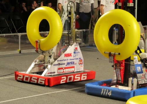 Two robots compete in the FIRST Robotics Waterloo Regional