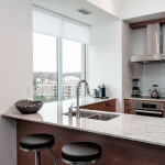 Condo Kitchen by Parsons Interiros