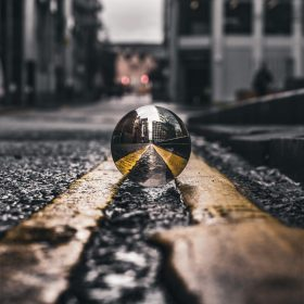 selective-focus-photo-of-lensball-on-asphalt-road-2251798
