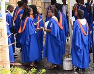 UWI graduates in their blue gowns. UWI Open Campus graduation.