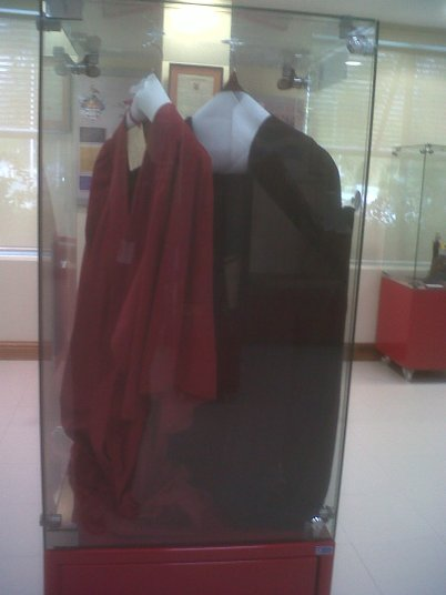 Original student (scarlet) and graduate gowns.