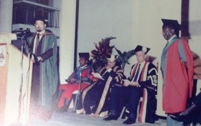UWI Orator reads a citation to an Hon Graduand. Seated from right are the Vice-Chancellor, Chancellor and Hon Graduand in their traditional robes