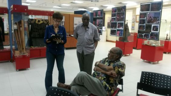 Alumni Archie Hudson Phillips (sitting) and Aggrey Burke pepper the Curator with recollections
