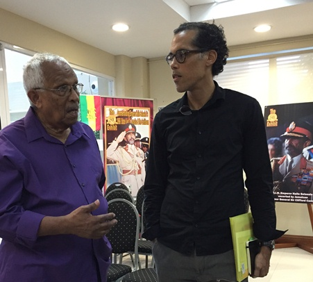 Filmmaker Franklyn St Juste, who covered the Selassie visit chats with Prof Matthew Smith (right), Director of the UWI Mona Social History Project, who moderated the session