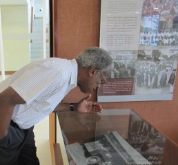 Checking out a historic image in the UWI Museum