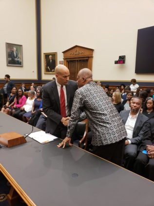 Professor Sir Hilary Beckles with Senator Cory Booker.