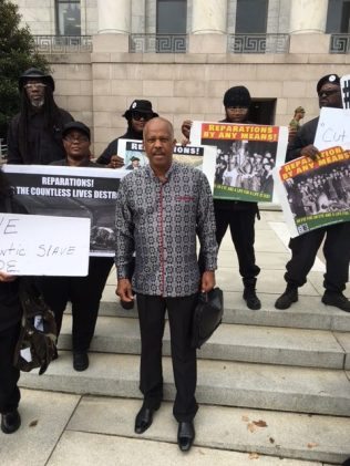 Professor Sir Hilary Beckles greeted by members of the new Black Panther Party.