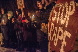 COMMUNITY MEMBERS HOLD CANDLELIGHT PROCESSION OVER VIOLENCE AGAINST WOMEN