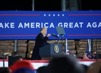 President Donald Trump (R) speaks at a rally in Duluth, Minnesota on Wednesday, Sept. 30.