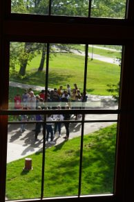 Freshman students mill about outside of Erlanson hall, groups were staggered as they entered buildings on campus with only one guided group in most buildings at the same time.