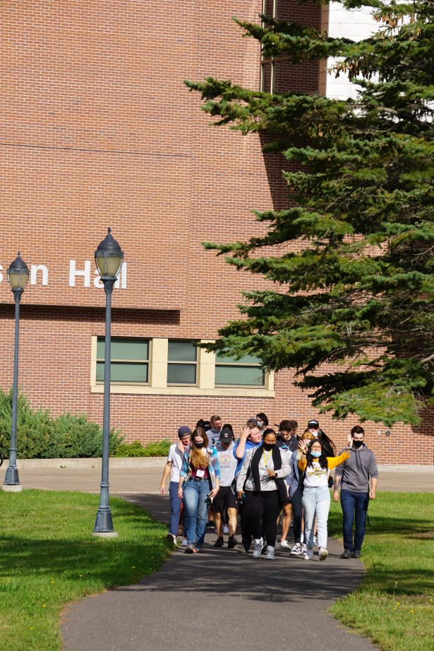 Students on their tour of campus depart from Swenson Hall and trek across the quad.