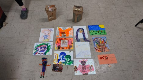 """Artwork created by students during the """"Bad Art Night"""" floor program. Photo by Drew Kerner."""