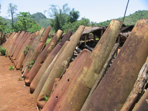Laos Plain of Jars - village fence made of American bombs copy 2