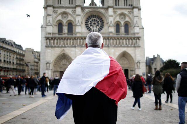 french-tourist-holding-France-flag
