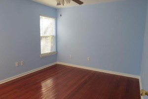 Middle bedroom with hardwood floor