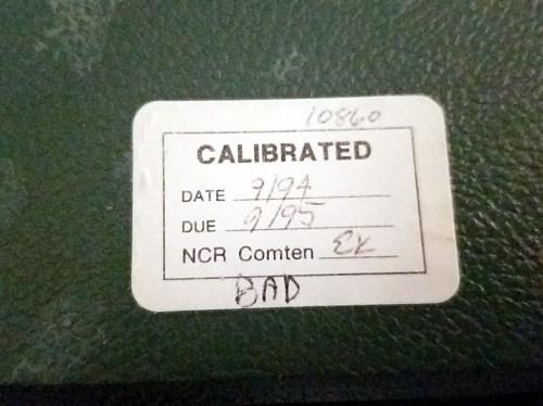 Calibration sticker dated September 1994 on the Fluke 8000A