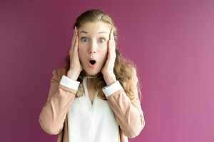 woman with a scared look - Do the Math: Downtime Costs Your Business Money