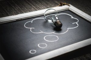 lightbulb on chalkboard cloud - The End of the Line: Getting the Right IT Support When Your Technology Becomes Obsolete