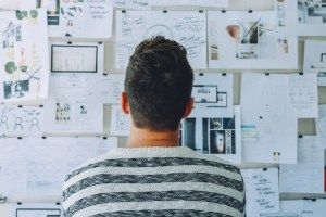 man looknig at wall and planning - Plan for the End Right From the Beginning: Incorporate End-of-Life Needs Into Your Overall IT Plan