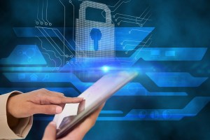 hand touching tablet with lock symbol - 7 Tips to Help Your IT Tech Support Team Maintain Security for a Remote Workforce