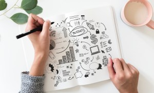 woman drawing up a business plan - Best Practices for Cloud Migration: How to Create a Successful Strategy