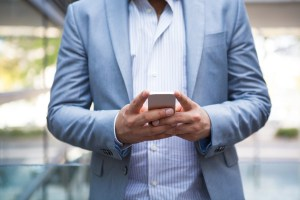 man checking his phone - BYOD Is the New Normal: How to Make it Work for Your Business