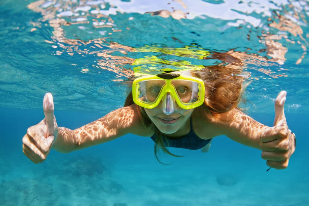 active young woman in snorkeling by Vacancy Rewards