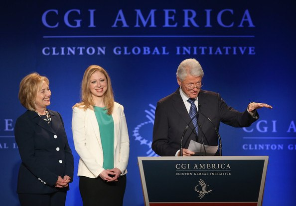 Clinton Global Initiative image with Bill, Hillary, and Chelsea