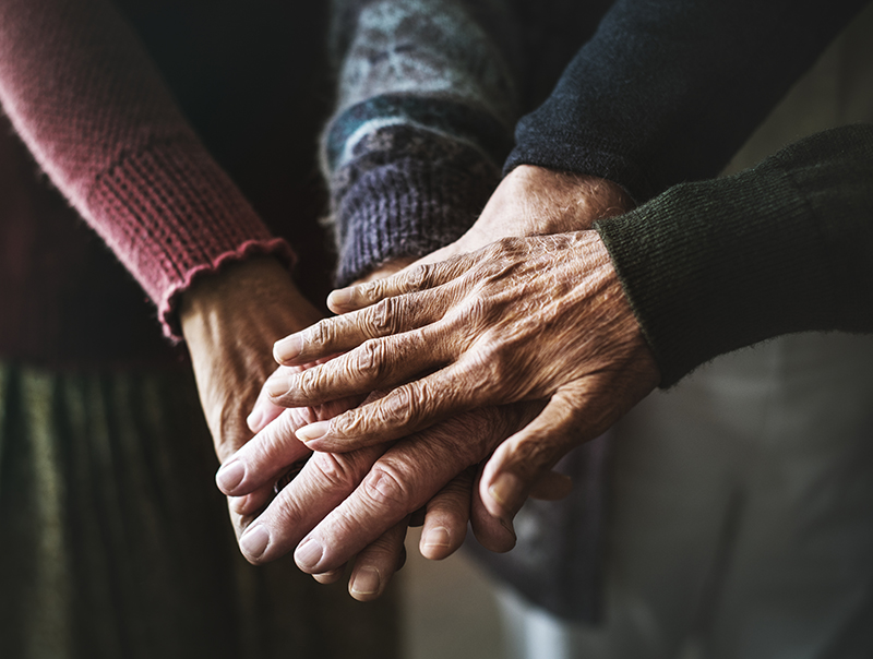 Closeup of hands of senior citizens