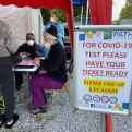PATHS staff registering someone for testing at the COVID-19 mobile event