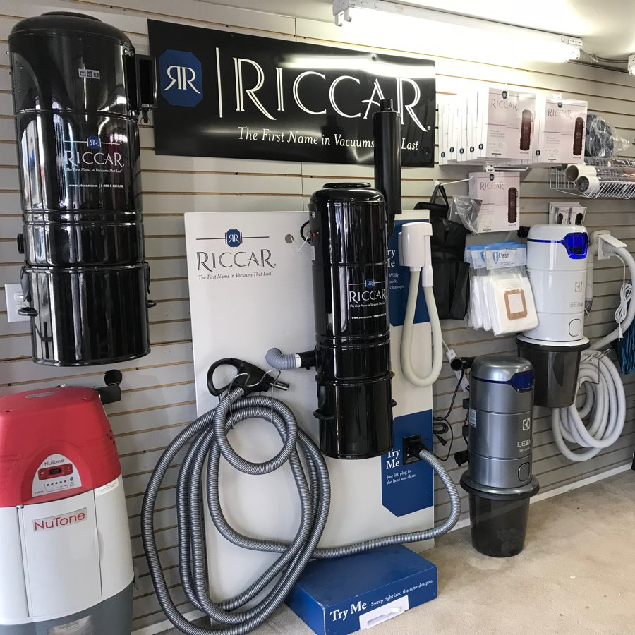 central vacuum brands displayed on the wall, Beam, NuTone, Riccar, central vacuum parts