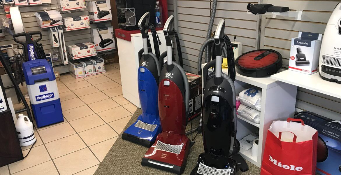 Vacuum store. RugDoctor shampooer, three upright vacuum cleaners, Miele RX2 robot vacuum.