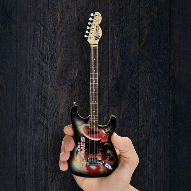 calgary flames woodrow miniature guitar - nhl auctions