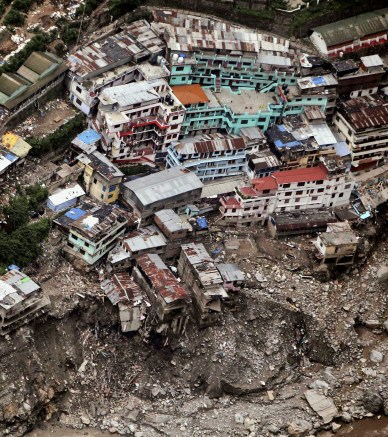 A view of damaged houses is seen following floods and cloudburst in Srinagar, Uttarakhand, India