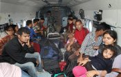 Stranded people being rescued by Indian Air Force at Guptakashi near flood-hit Kedarnath in Uttarakhand on Thursday.
