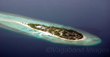 This is an inhabited island but see the corals surrounding it